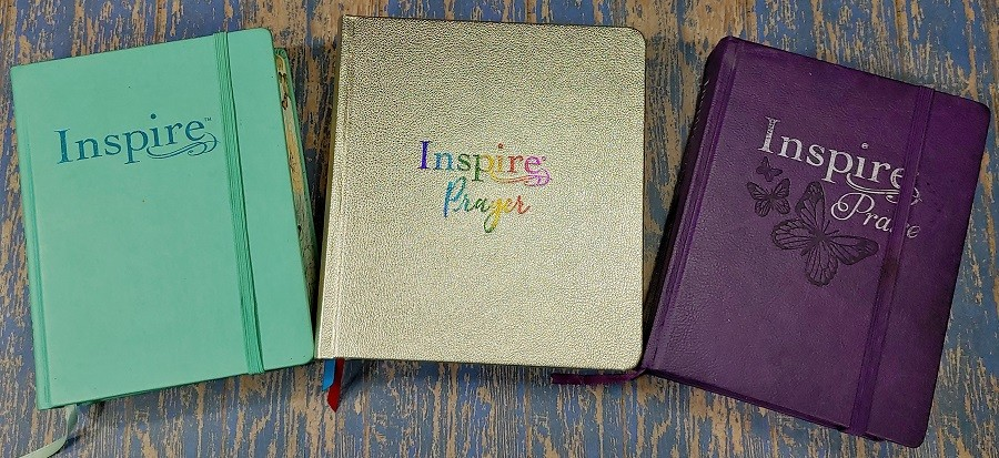 Hardcover versions of the NLT Inspire Bible Line